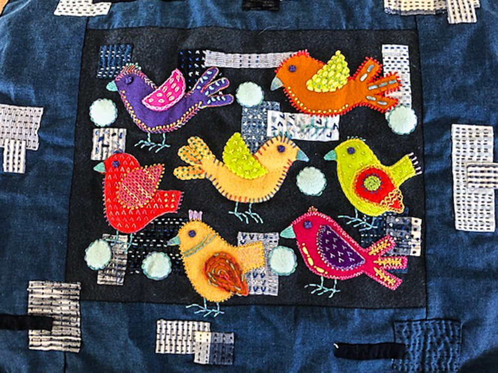 Twitter designed by Sue Spargo, stitched by Marj